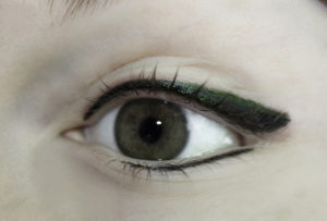 Permanent Eyeliner With moss-green shadow just above black line